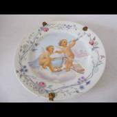 Assiette porcelaine decor d'angelots